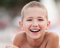 Handsome smiling child boy taking sunbath