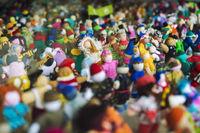 Hundreds of colorful dolls standing side by side. Bruges, Flanders, Belgium