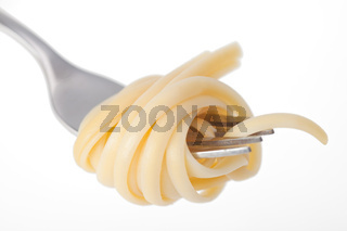 spaghetti on a fork on white background