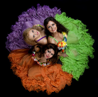 Three woman in color carnival costume