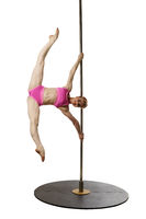 Smiling gymnast poses during workout on pole