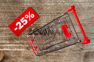 Shopping cart with tag of discount.