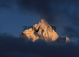 Peak of mount Ama Dablam at sunset