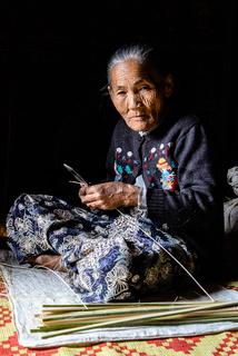 elderly burmese woman in a mountain village around Inle Lake
