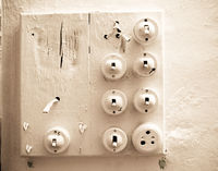 a colection of old worn light switches painted