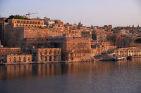 The early morning view of Valletta fortifications from the water of Grand Harbour. Malta