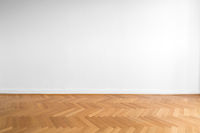 wooden parquet floor and white wall background - empty room , new flat