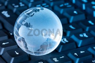 Glass globe on the keyboard