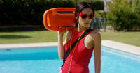 Serious lifeguard holding floatation device