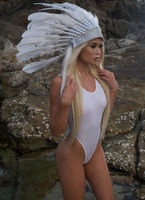 Woman in white indian feather hat