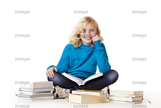 Schoolgirl  learning with study books sitting