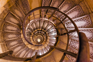 Spiral stairs inside Arc de triomphe in Paris France