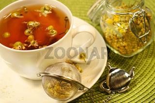 Chamomile  tea with white tea cup