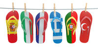 Hanging flip flops in colors of  different mediterranean european countries Spain, Italy, France, Portugal, Greece and Turkey. Travel and tourism concept.