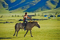 Boy on a horseback in the steppe, Orkhon Valley, Mongolia