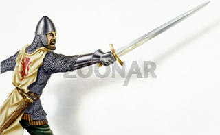 Middle age Ancient warrior with a sword, in action. On white background with dropped shadow.