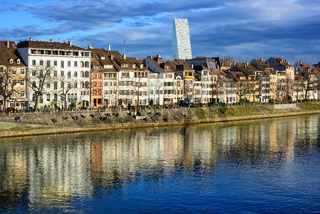 Houses along the Rhine river with Roche Tower in background, Basel, Switzerland