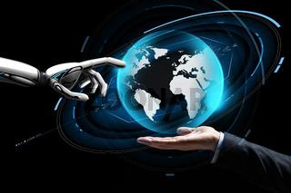 human and robot hand with virtual earth hologram