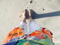 Sandy feet on the beach