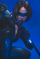 Killer, Brunette girl dressed in leather and latex fitted with japanese swords on blue background