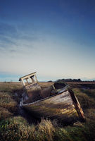 The sunsets on the old boat abandoned on Thornham Saltmarsh, Norfolk.