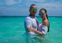 Attractive young couple in the sea