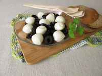 Antipasto with black olives and mozzarella balls in olive oil