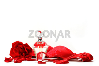 Perfume bottle,  rose and red brassiere