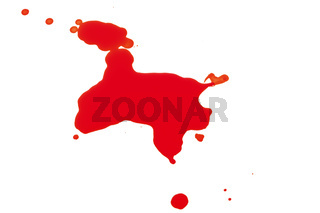 Syringe Squirting Red Blood onto White Background