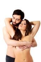 Sexy heterosexual couple embracing.