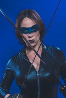 Costume, Brunette girl dressed in leather and latex fitted with japanese swords on blue background