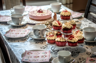 Cupcakes and cake on coffee table