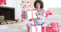 Surprised woman holding a large Christmas gift