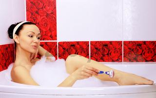 Shaving in the bath.
