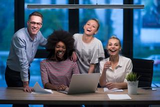 Multiethnic startup business team in night office