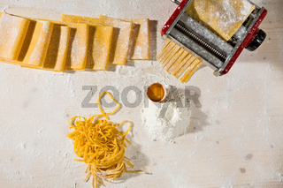 Ingredients for tagliatelle pasta and machine pasta cutter