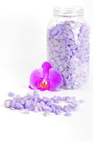 Salt in the bottle and orchid flower