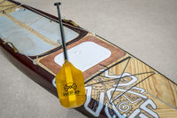 Preparing expedition stand up paddleboard for a trip