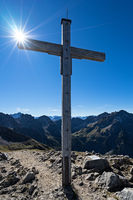 Summit cross Mt. Hammerspitze with sun
