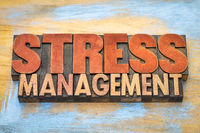 stress management word abstract in wood type