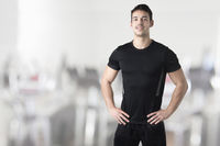 Personal Trainer With Hands on Waist
