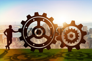 Businessman in teamwork concept with cogwheels