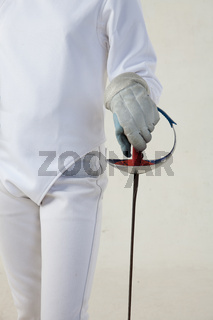 Female fencer hold the epee isolated on white background