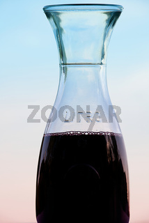 Italian carafe with red wine at outdoor restaurant
