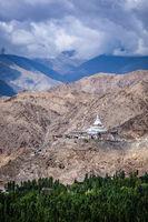 Buddhist stupa (chorten) on a hilltop in Himalayas