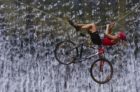 Crossing a waterfall on a rope with the bike