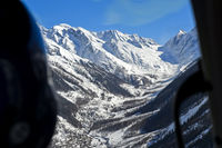 Bird's eye view from a helicopter across the Lötschnetal Valley to the Bernese Alps