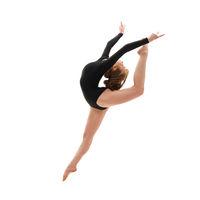 Young gymnast in elegant jump studio shot