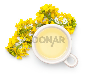 Rapeseed Oil and Flowers Isolated on White Background