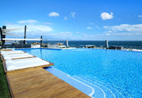Poolside and view to the Mediterranean Sea. Spain